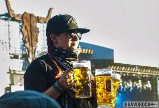 a girl with three beers at wacken 2018