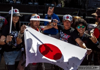 four Japanesewith a flag at wacken 2018
