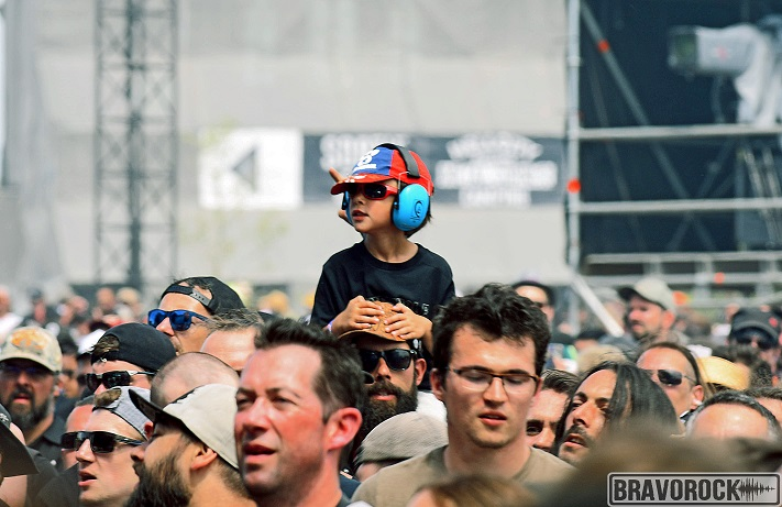 Father carrying child on his back - Hellfest 2019